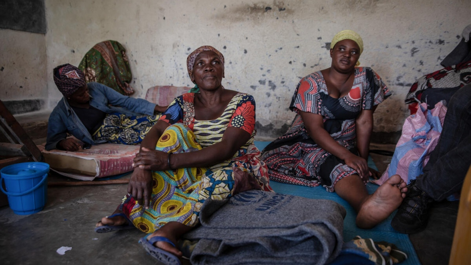 Juliene Bushashire (centre) fled Goma on foot with her 10 children and walked for two days to reach Sake.