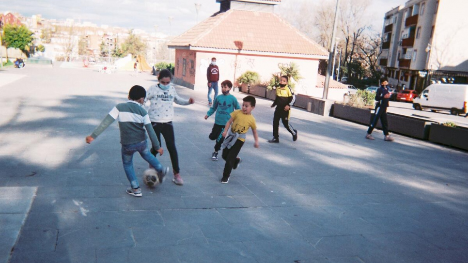 Young people from the CAR Alcobendas refugee reception centre north of Madrid play a game of football.