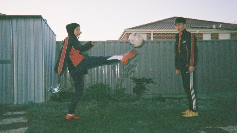Young refugees from the Melbourne Victory FC football programme kick a ball in Melbourne, Victoria, Australia.