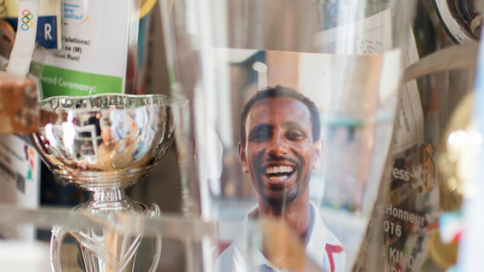 """Yonas with his collection of racing trophies. """"I really miss my competitions."""""""