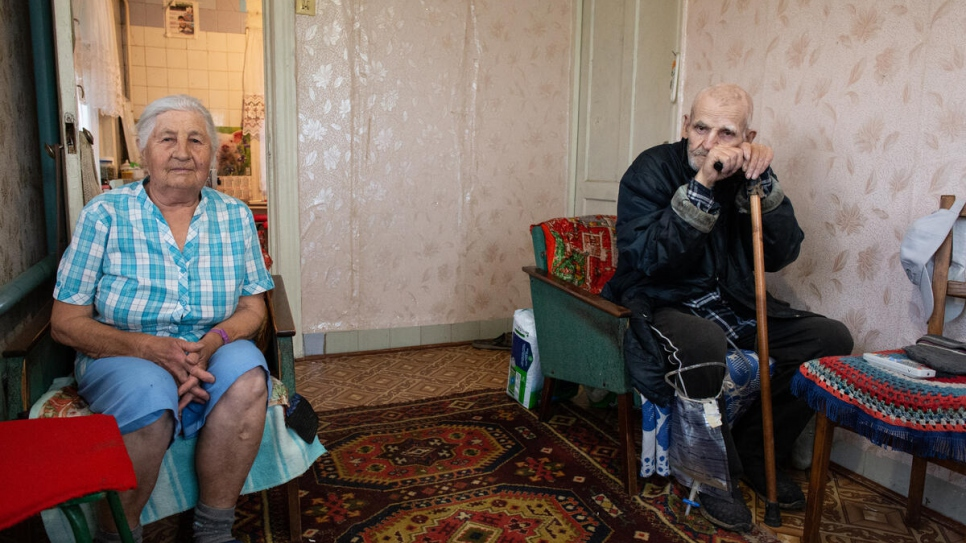 Viktor and his wife, Antonina Akimov, 84, in their home in Stanytsia Luhanska. Viktor has serious health issues and struggles to walk.