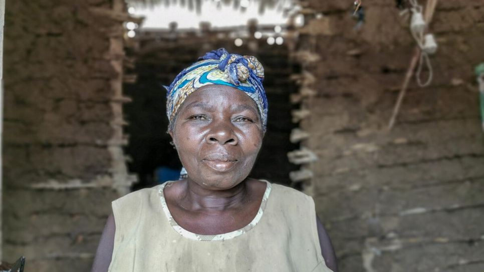 Kahambu Mwavuli, 57, stands inside one of the houses in her compound where she accommodates 25 people in Beni, in north-eastern Democratic Republic of the Congo.