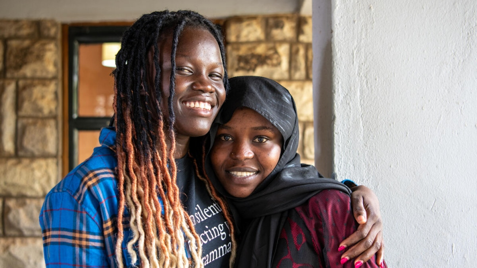 Raba, from Sudan, poses with new friend Adah Wilson, from South Sudan, at the United States International University - Africa.