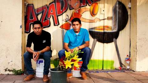Mexico. Central American Refugees Jose Ismael and Leonel Antonio Diaz sell flowers in the streets of Tapachula, Mexico.