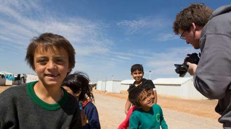 Jordan. UNHCR High Profile Supporter John Green in Azraq refugee camp