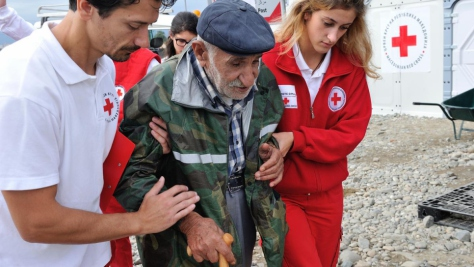 The Former Yugoslav Republic of Macedonia. Syrian refugee, Ismail Ibrahim assisted by the Red Cross at Vinjug Reception Centre