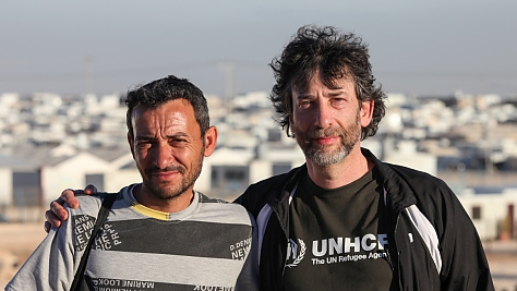 Jordan. UNHCR High Profile Supporter Neil Gaiman visits refugees at Zaatari camp