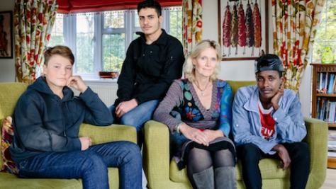 United Kingdom. Ingrid Van Loo Plowman and her youngest son Ross, host three refugees in their home in Epsom, near London: Isak, 18, from Ethiopia, 19-year-old Abdul, from Syria and a 31-year-old engineer from the Middle East who declined to be identified for security reasons. This portrait is part