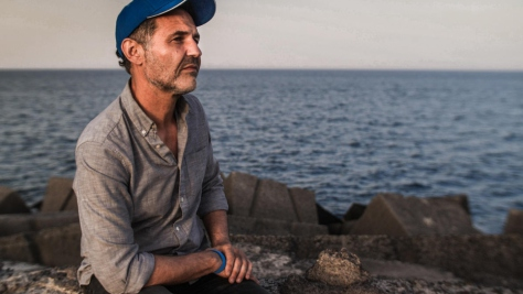 Italy. UNHCR Goodwill Ambassador Khaled Hosseini meets refugees who have survived the perilous sea crossing to Europe