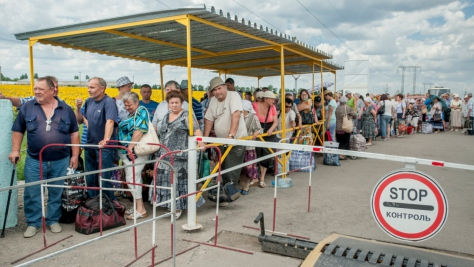 Ukraine. Families wait to pass through a checkpoint in Marinka, close to the conflict zone