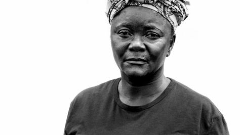 Black-and-white portrait of a Congolese refugee woman facing the camera.