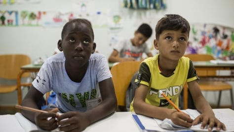 Greece. Refugee children in Kos waiting for a chance to attend school