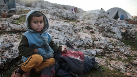 Syria. Young displaced boy fleeing violence near Idlib