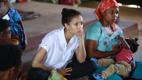 Uganda. UNHCR Supporter Gugu Mbatha-Raw at the Women's Centre in Nakivale Refugee Settlement, with Sifa Semeki, a refugee.