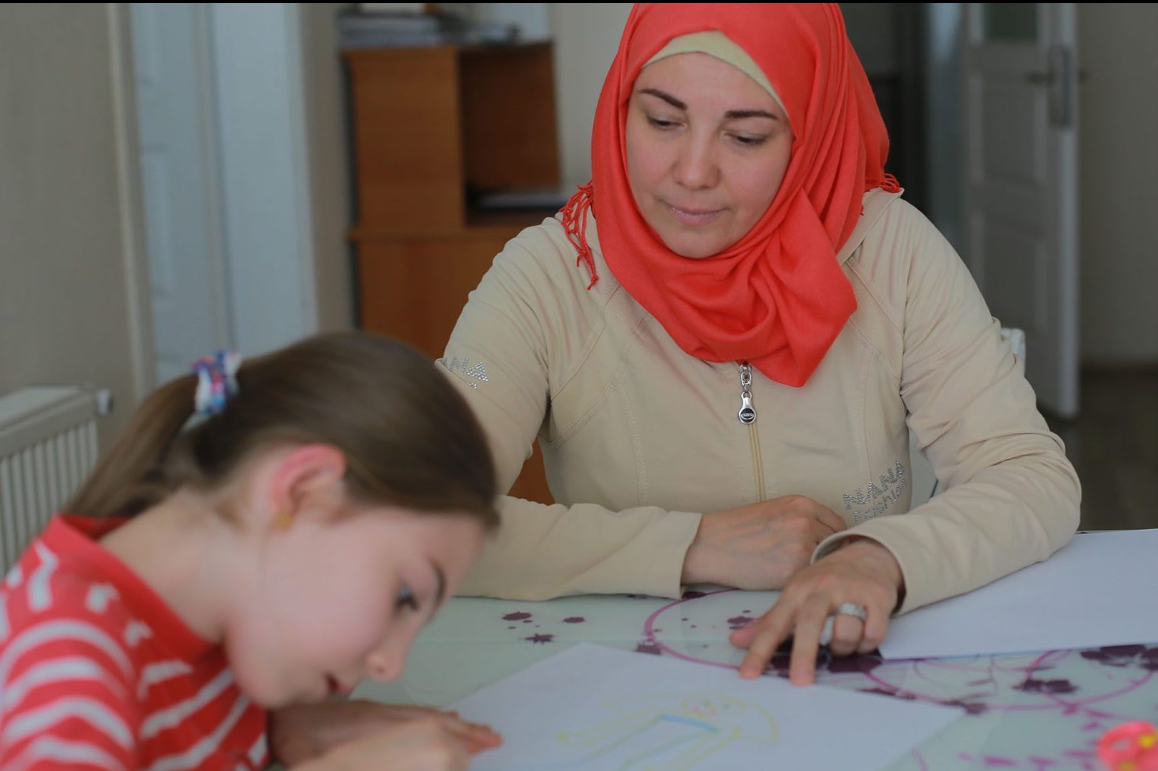 Darie Alikaj fled barrel bombs and mortar fire in Syria, leaving behind her job as a microbiologist. Now she mirrors a wider world of refugee survival in Turkey.