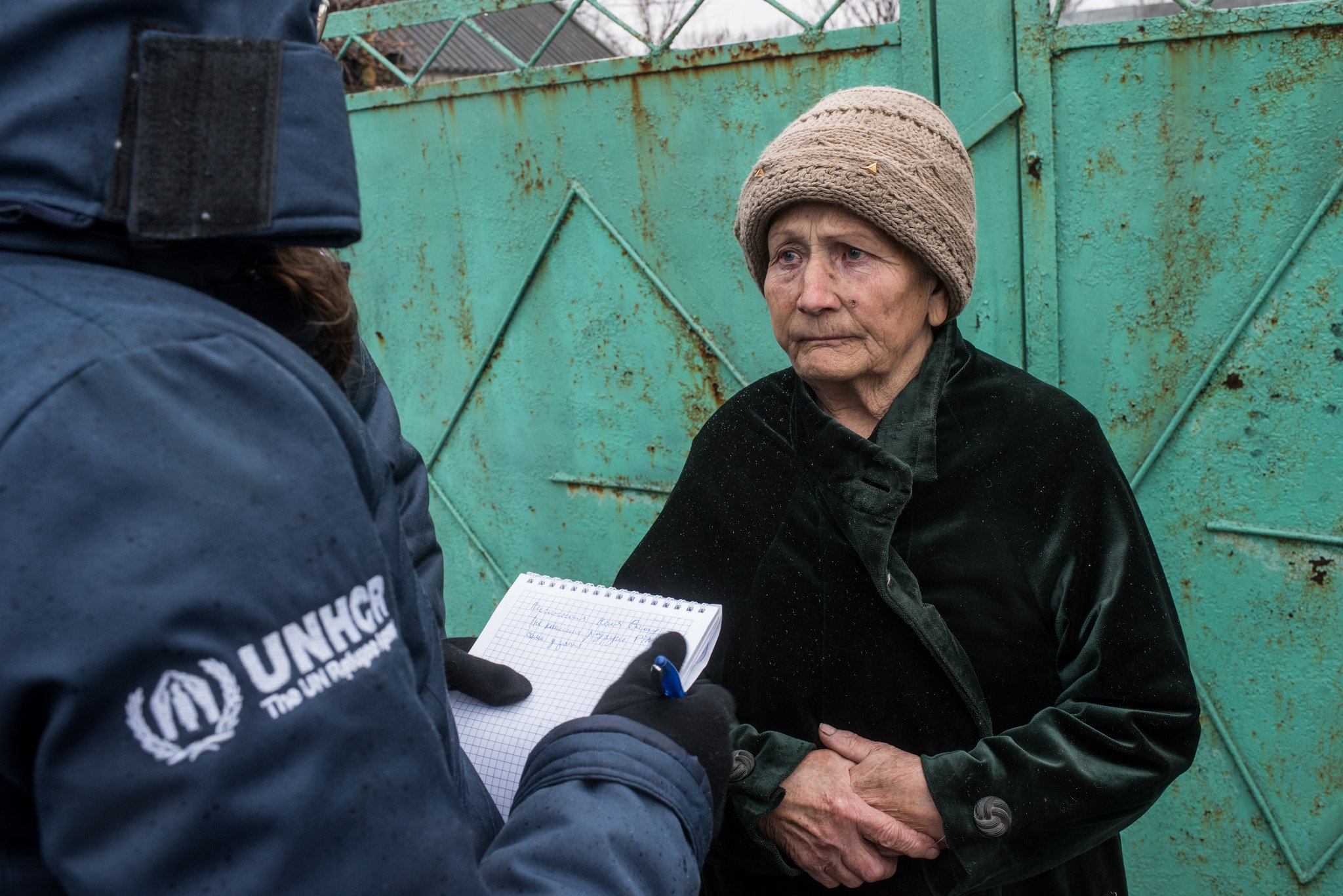A woman speaks with UNHCR at the frontline village of Luhanske on 12 January 2017.