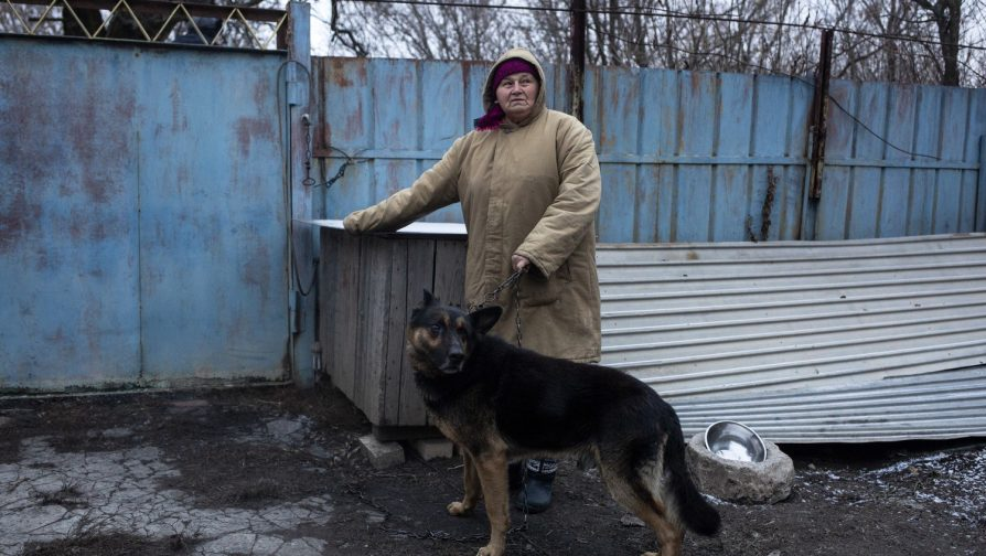 Stefania and her dog outside the neighbour's house where she is living in Mykolayivka, Donetsk. ©UNHCR/Anastasia Vlasova