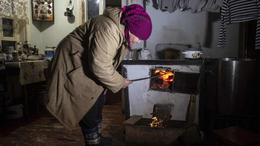 Stefania has been given four tons of coal by UNHCR, helping her to keep warm and cook. ©UNHCR/Anastasia Vlasova