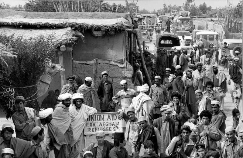 The exodus of more than 6 million Afghans started in 1979. People fled to such sites as the Ghazi Refugee Village in Pakistan. © UNHCR/H. Gloaguen/1984