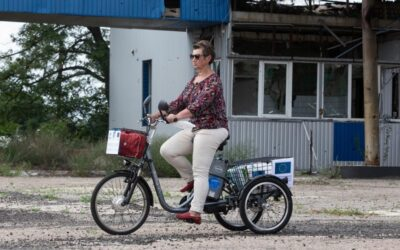 Volunteer cyclists deliver aid to isolated communities in eastern Ukraine